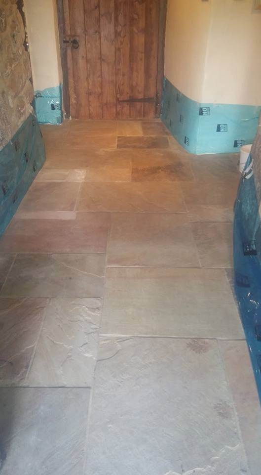 Flood Damaged Sandstone Tiled Floor Chagford Before Restoration